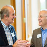 Two guests chatting at the Retiree Reception.